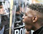 Black Lives Matter protester confronts police during a protest in the United States.