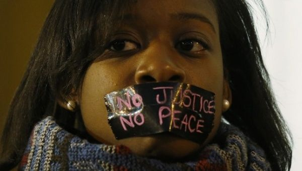 A protester during a silent demonstration after a white Ferguson police officer shot and killed Michael Brown, an unarmed black teenager, in St. Louis, Missouri, March 14, 2015