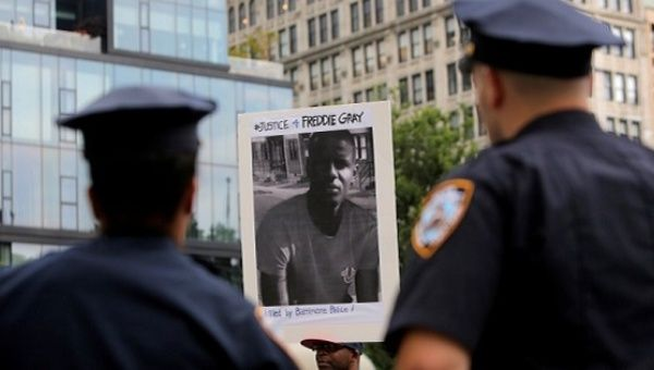 A man participates in a protest after Baltimore Police Officer Caesar Goodson Jr. was acquitted of all charges for his involvement in the death of Freddie Gray.