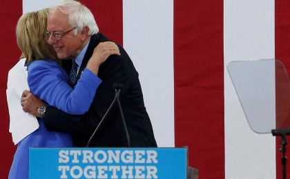 Democratic U.S. presidential candidate Hillary Clinton and Senator Bernie Sanders embrace during a campaign rally where Sanders endorsed Clinton in Portsmouth, New Hampshire, U.S., July 12, 2016.