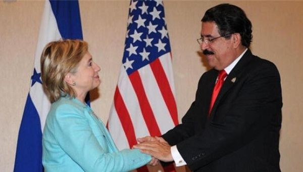 Honduras President Manuel Zelaya shakes hands with then US Secretary of State Hillary Clinton in 2006.
