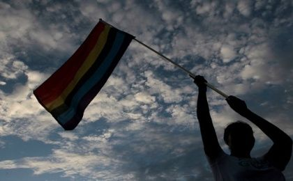 A participant holds up a rainbow flag during a gay pride parade in Managua, Nicaragua, June 28, 2016.