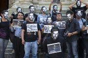 Mexican protesters wear Ruben Espinosa masks, a Mexican journalist who was killed while in hiding, during a demonstration against impunity in Oaxaca, Mexico, August 2, 2015.