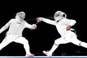 Russia's Alexey Yakimenko (L) competes against Daryl Homer of the U.S. during their men's sabre final at the World Fencing Championships in Moscow July 14, 2015.