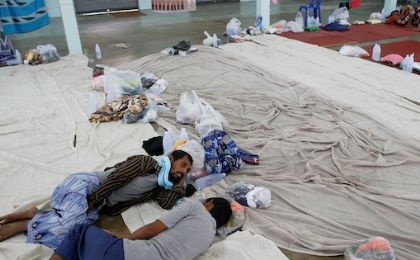 Suspected victims of human trafficking rest at a government shelter in Takua Pa district of Phang Nga, Thailand, October 17, 2014.