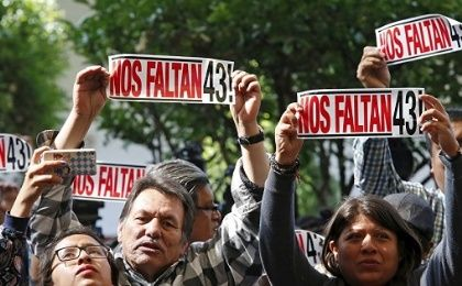 "Protesters holding signs that read ""We are missing 43"" in Mexico City"