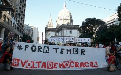 Protesters take part in a demonstration against coup-imposed President Michel Temer in the center of Rio de Janeiro, Brazil, July 31, 2016.