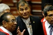 Ecuador's President Rafael Correa (C) talks with Congress members before the inauguration of Peru's president, July 28, 2016.