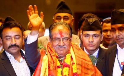 Nepal's newly elected Prime Minister Pushpa Kamal Dahal, also known as Prachanda, waves towards the media after he was elected Nepal's 24th prime minister in 26 years, in Kathmandu, Nepal.