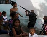 Police officers and residents in a favela in Rio de Janeiro in May 2015.