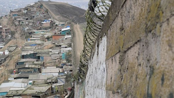 Residents on the poor side have to travel an hour to bypass the wall.