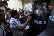 Teachers scuffle with police blocking the access to a commercial area during a protest against President Enrique Pena Nieto's education reform, in Monterrey, Mexico July 13, 2016.