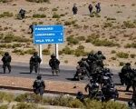 Riot policemen gather at a blocked main highway during a right-wing protest against Bolivia's President Evo Morales' government policies, in Panduro south of La Paz, Bolivia, August 25, 2016.