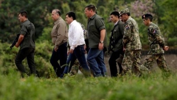 Paraguayan President Horacio Cartes arrives at Horqueta in the region of Concepcion, Aug. 28, 2016, to visit soldiers a day after eight were killed.