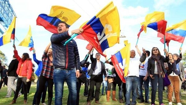 "Colombians wave flags in support of a ""Yes"" vote in the plebiscite on the peace deal with the FARC in Bogota, Aug. 26, 2016."