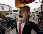 A man looks at a piñata depicting U.S. Republican presidential candidate Donald Trump hanging outside a workshop in Reynosa, Mexico, June 23, 2015.