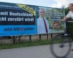 Election posters of the right-wing Alternative for Germany and Social Democratic Party are seen in Greifswald, Germany August 30, 2016.