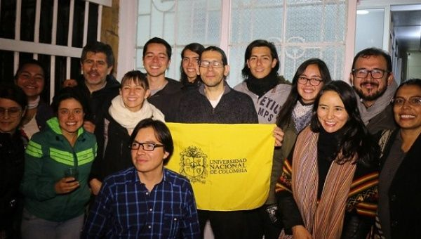 Miguel Angel Beltran poses with the flag of the National University alongside students and supporters shortly after his release from prison, Bogota, Colombia, September 1, 2016.