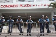 Police stand guard at the entrance of the Condado Plaza Hilton, at which the first seminar of the Puerto Rico Oversight, Management and Economic Stability Act (PROMESA) is scheduled to be held.