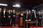 Colombia's President Santos signs the plebiscite decree at the Narino palace in Bogota.