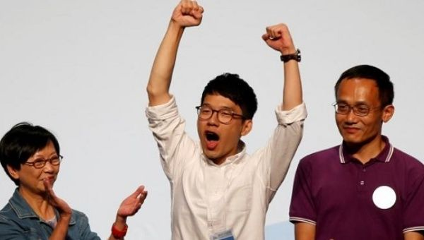 Nathan Law (C) celebrates his win in the Legislative Council election in Hong Kong, China September 5, 2016.