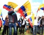 Colombians wave flags in support of a
