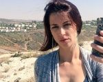 Abby Martin holds up a tear gas canister in the Occupied Territories.