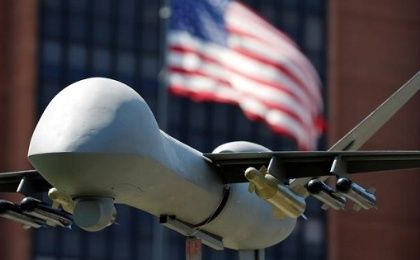 A model of a military drone is seen in front of an U.S. flag