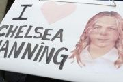 An activist holds a sign during a protest to demand the release of Chelsea Manning.