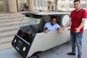Khalid al-Bardawil and Jamal al-Miqat, engineering students at the Al-Azhar University, pose with their vehicle.