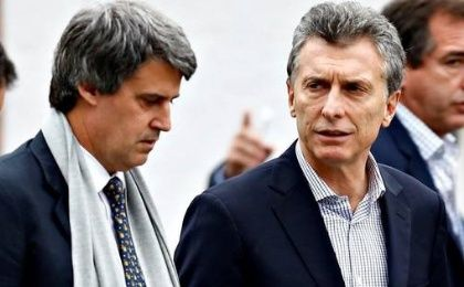 Finance Minister Alfonso Prat-Gay next to President Mauricio Macri