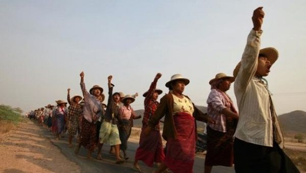 Villagers protest after their land was seized to allow for the expansion of a copper mine in Sagaing Division, March 13, 2013.
