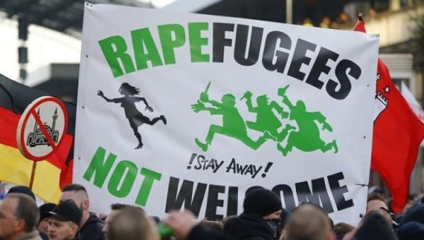 Right-wing anti-immigration supporters rally in Cologne, Germany.