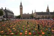 A display of life jackets worn by refugees during their crossing from Turkey to Greece are seen in Parliament Square in the U.K., Sept. 19, 2016.