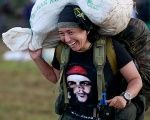 A fighter from the FARC-EP arrives at the camp where the rebels are discussing the peace deal.