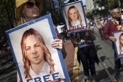 People hold signs calling for the release of Chelsea Manning in San Francisco.