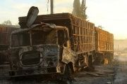 Damaged aid trucks are pictured after an airstrike on the rebel held Urm al-Kubra town, western Aleppo city, Syria September 20, 2016.
