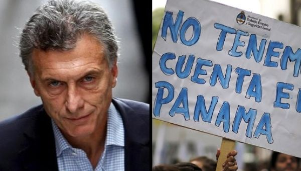 "A protest sign against Argentine President Mauricio Macri reads: ""We don"