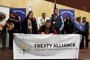 Grand Chief Stewart Phillip signs the Treaty Alliance Against Tar Sands Expansion with other First Nations leaders in Vancouver, Sept. 22, 2016.