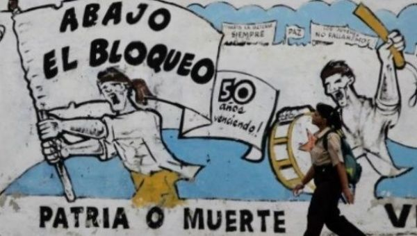"Graffiti in Cuba reads ""Down with the blockade"" and ""Homeland or Death."""