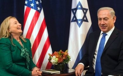 Then U.S. Secretary of State Hillary Clinton laughs during a meeting with Israeli Prime Minister Benjamin Netanyahu, September 27, 2012.