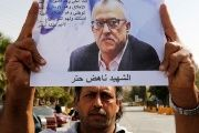 A relative of the Jordanian writer Nahed Hattar holds his picture during a sit-in in the town of Al-Fuheis.
