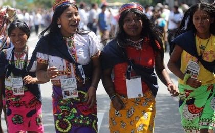 Members of Indigenous communities of the Antioquia department in Colombia participate in a peaceful march in Medellin, Aug. 11, 2011.