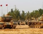 Turkish army tanks and military personal are stationed in Karkamis on the Turkish-Syrian border in the southeastern Gaziantep province, Turkey, August 25, 2016.