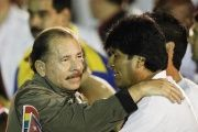 Nicaragua's President Daniel Ortega (L) hugs his Bolivian counterpart Evo Morales before the march of the torches in celebration of the 161th birth anniversary of Cuba's independence hero Jose Marti in Havana January 27, 2014.