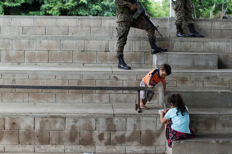 Children play at a shelter for displaced people from El Castano village in the town of Caluco.