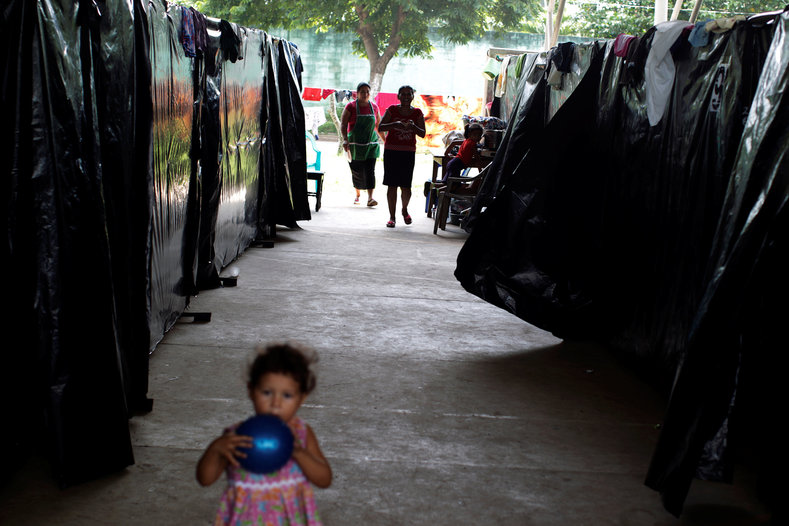 A girl plays at a shelter for displaced people from El Castano village in the town of Caluco.
