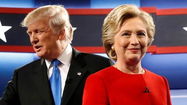 Trump and Clinton greet one another as they take the stage for their first debate at Hofstra University, New York, U.S.