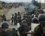 Peruvian riot police approach protesters in a crackdown that led to the massacre known as the