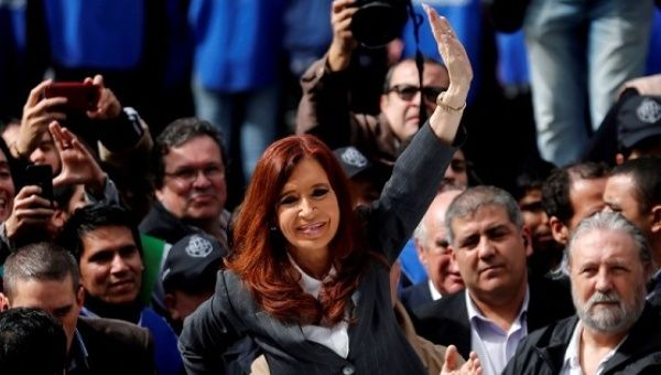 Former Argentine President Cristina Fernandez de Kirchner waves to supporters in Buenos Aires, Argentina, April 13, 2016.